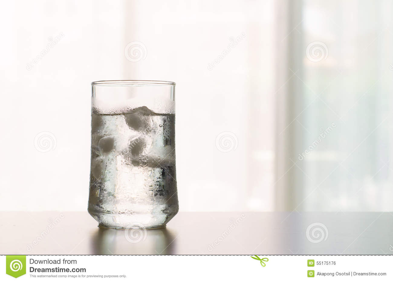 Glass Of Cool Fresh Drink With Ice Cube On The Table Stock