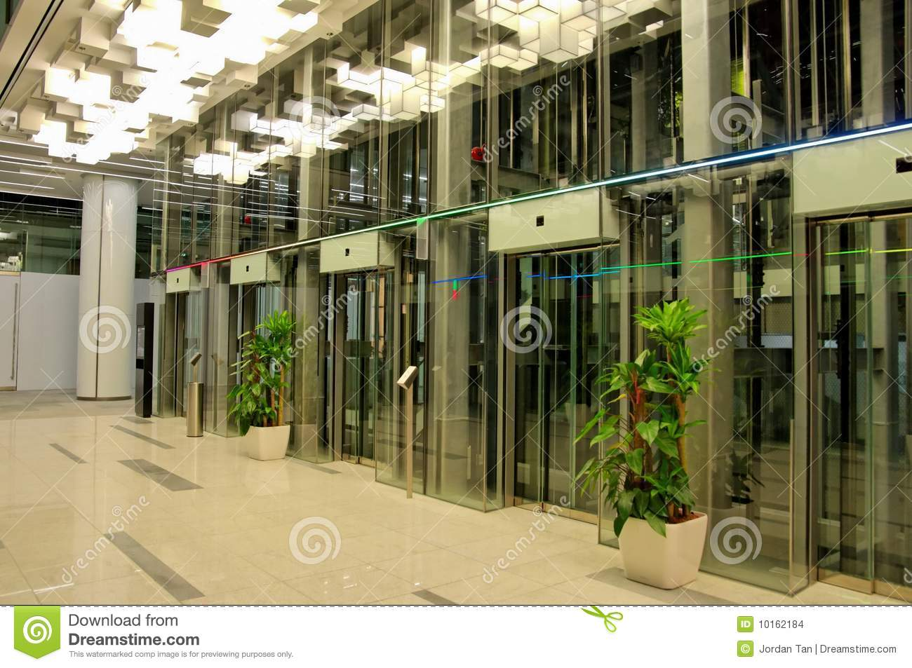 Glass elevators in new shopping mall stock images image for Window design ground floor