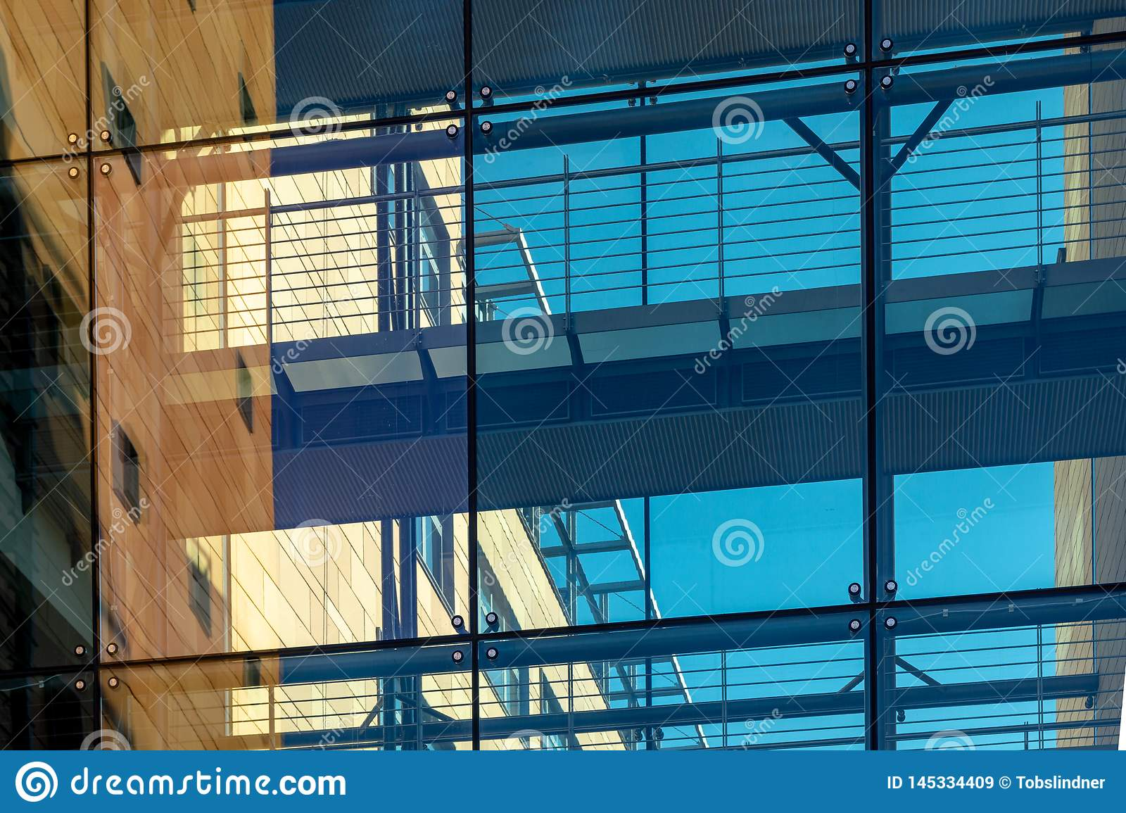 Glass facade of a modern building - orange and blue