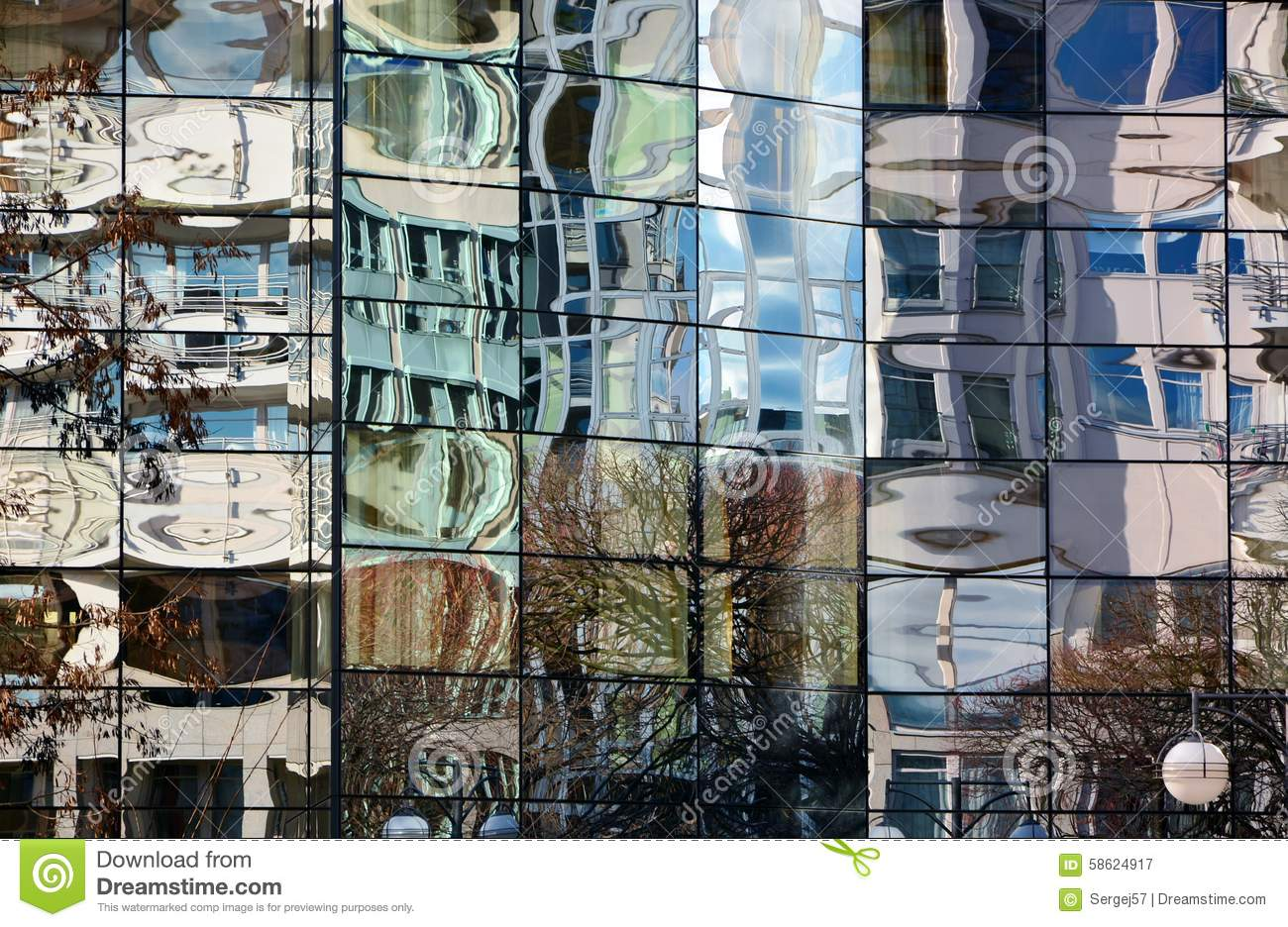 Glass facade of modern office building with blurred for Refection facade