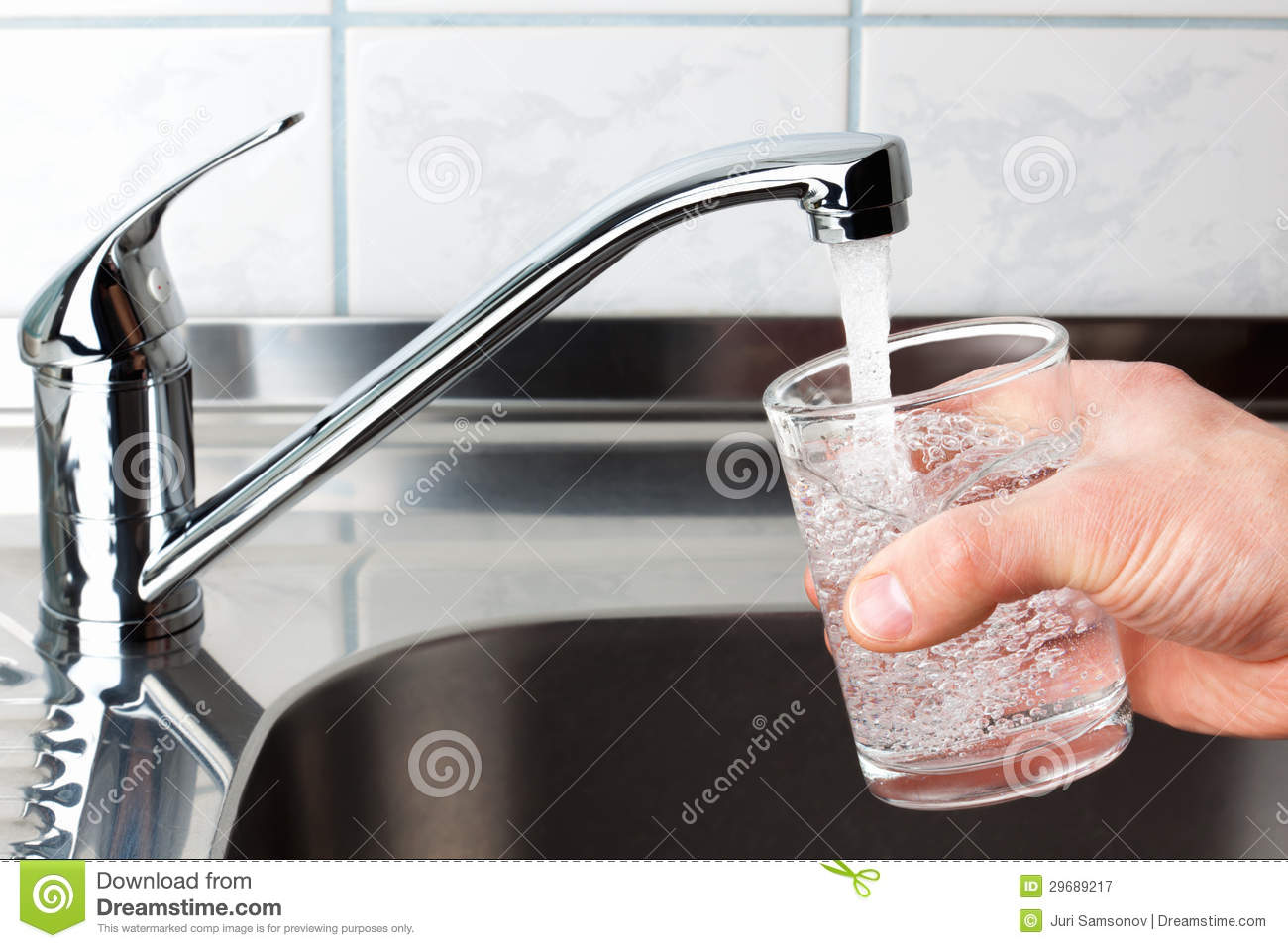 Glass Filled With Drinking Water From Kitchen Faucet Stock Image