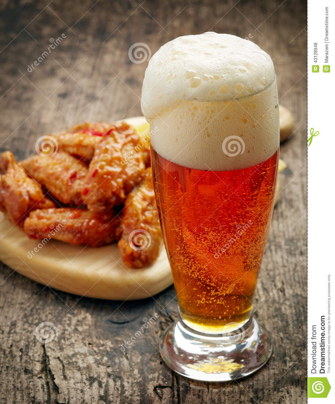 Glass Of Fresh Beer And Fried Chicken Wings Stock Photo ...