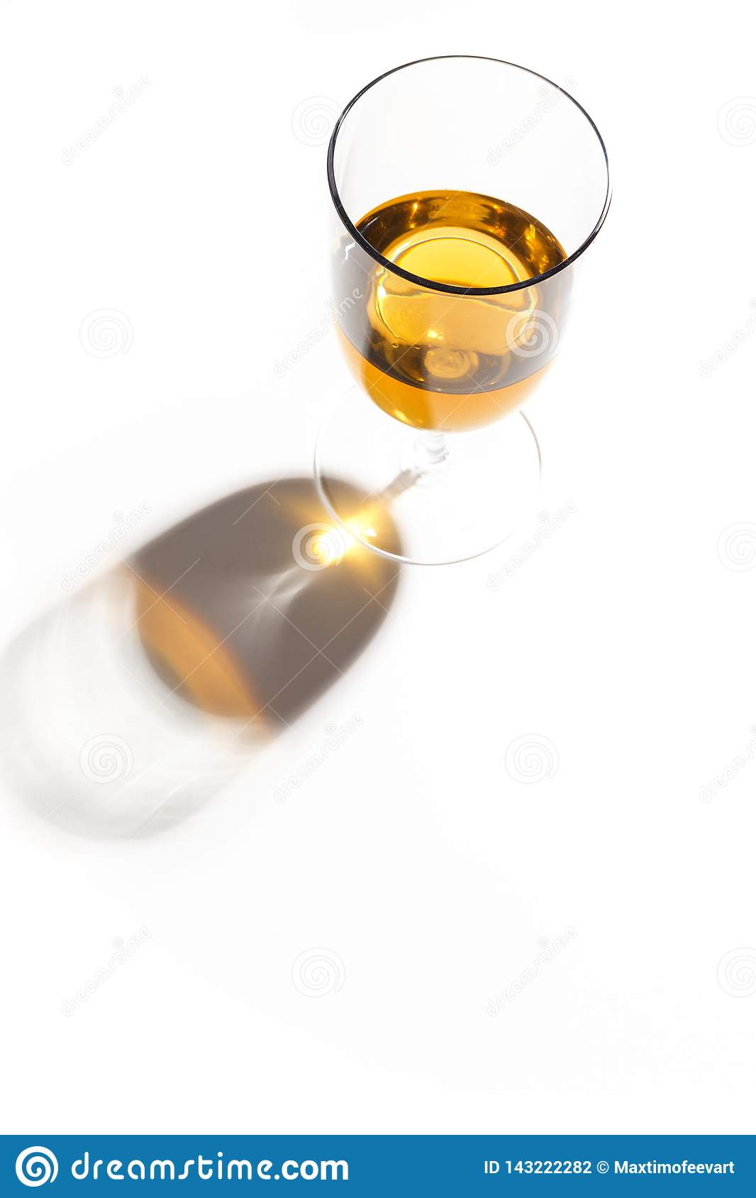 Glass glasses with drinks of different colors on a white background. Top view. The concept of an alcoholic cocktail