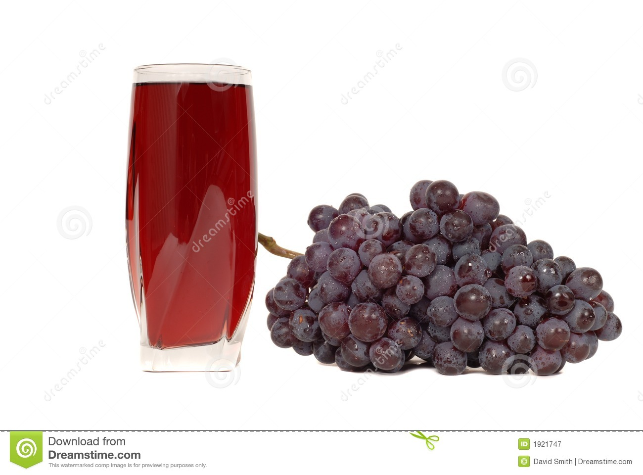A Glass Of Grape Juice With A Cluster Of Grapes Stock ...