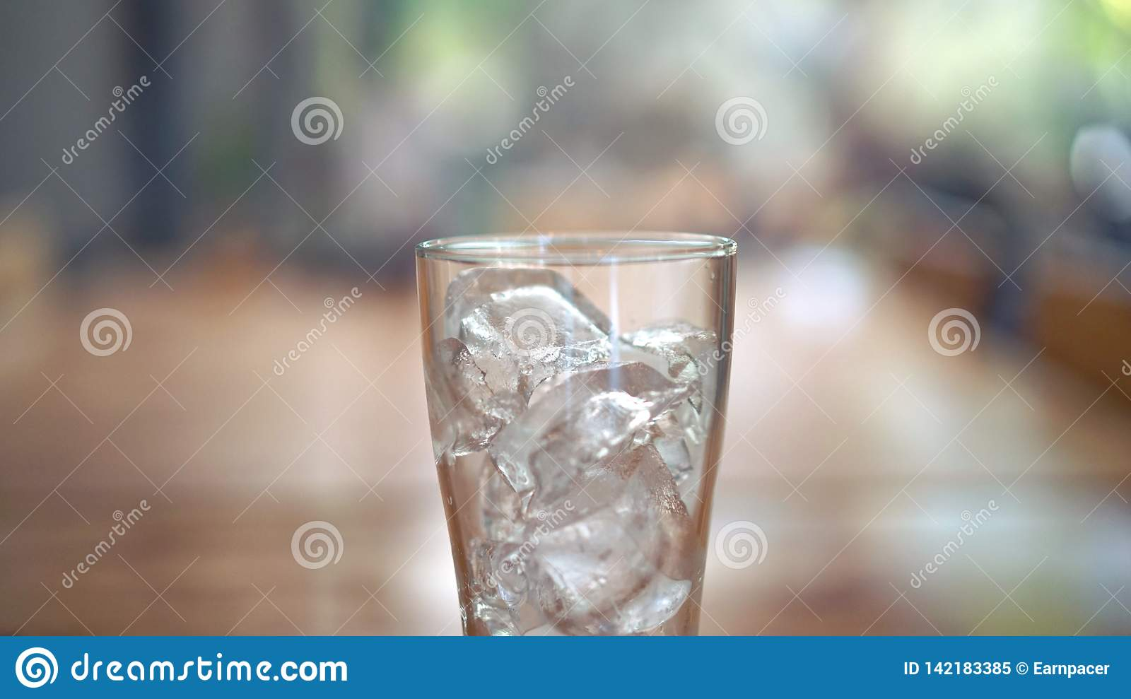 Glass of ice on the wooden table