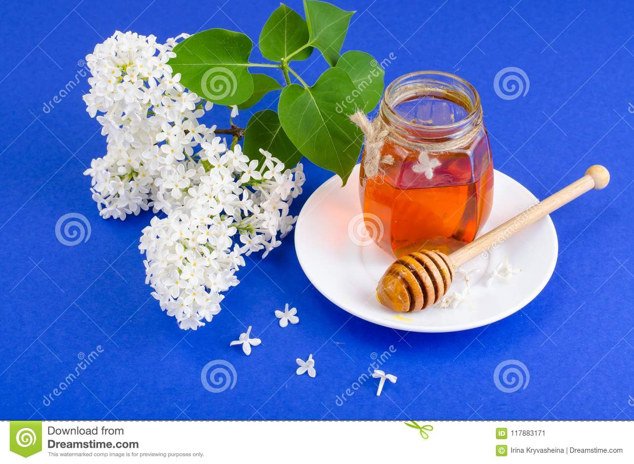 Glass jar with floral aromatic honey