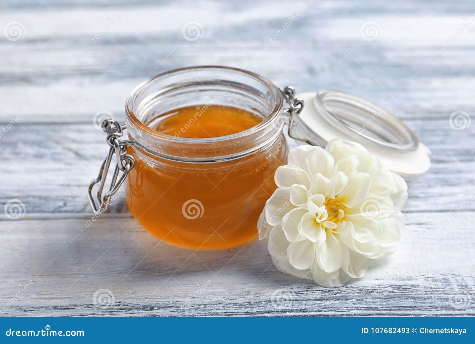 Glass jar with honey and white flower stock image image of golden download glass jar with honey and white flower stock image image of golden medicine mightylinksfo