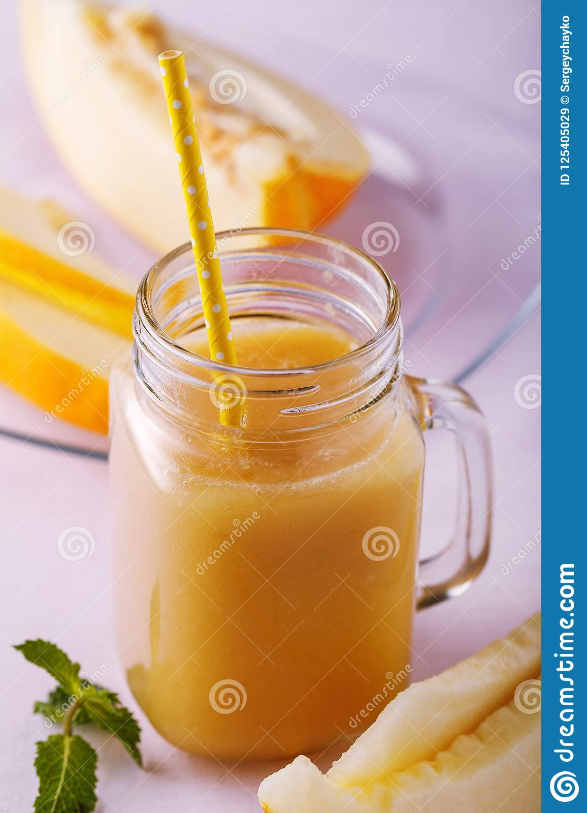 Glass jar of smoothies from pieces of melon on a wooden table