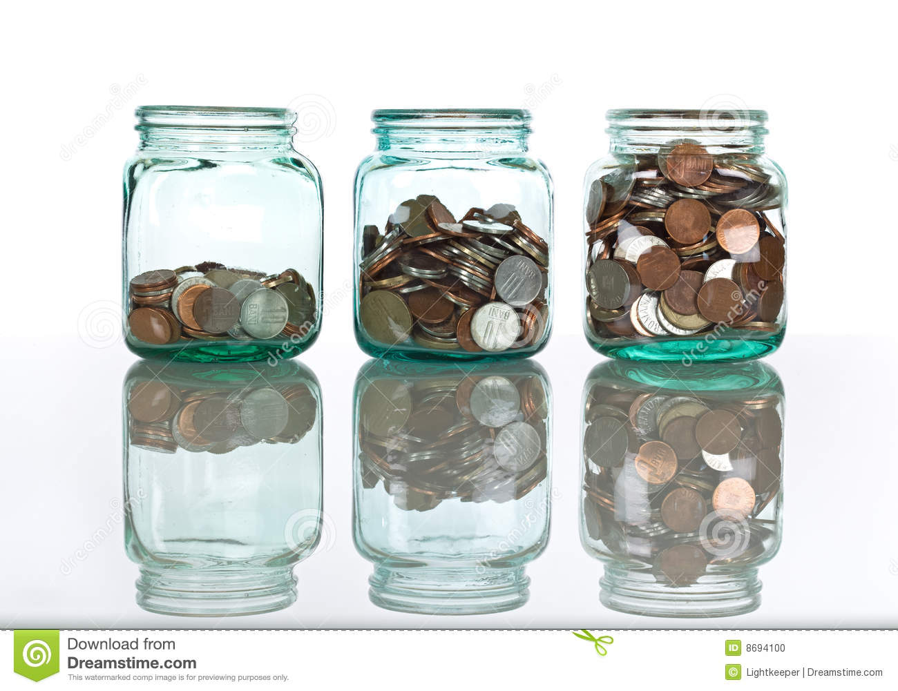 Glass jars with coins savings concept stock photo for Cool money jars