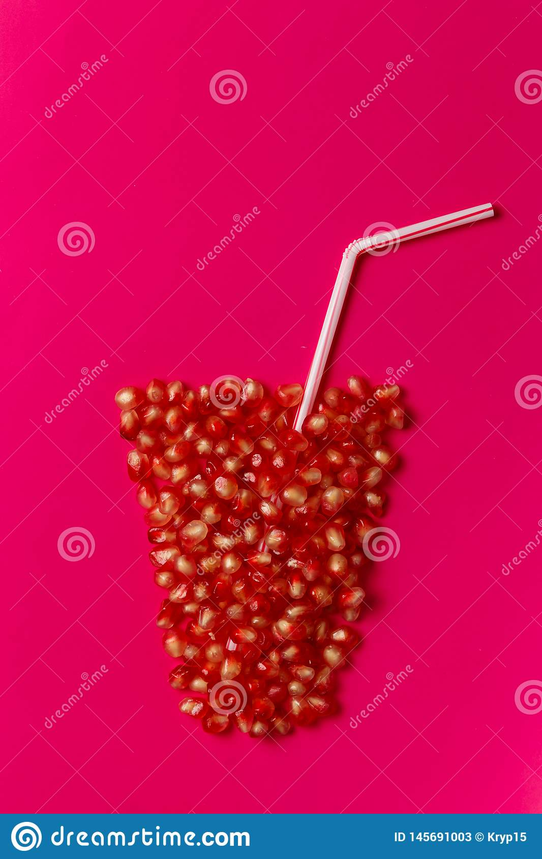 Glass of juice made of pomegranate seeds
