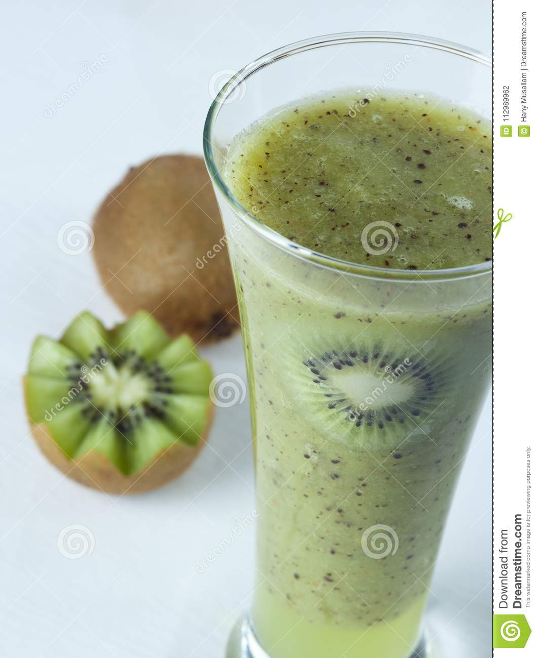 A glass of kiwi Juice with slices and fruits