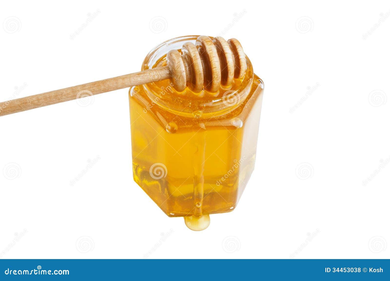 Glass krus av honung med trädrizzler
