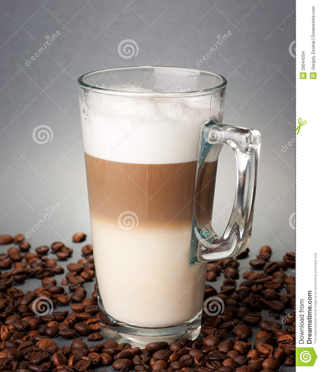 Glass Of Latte Macchiato On The Coffee Beans Stock Images