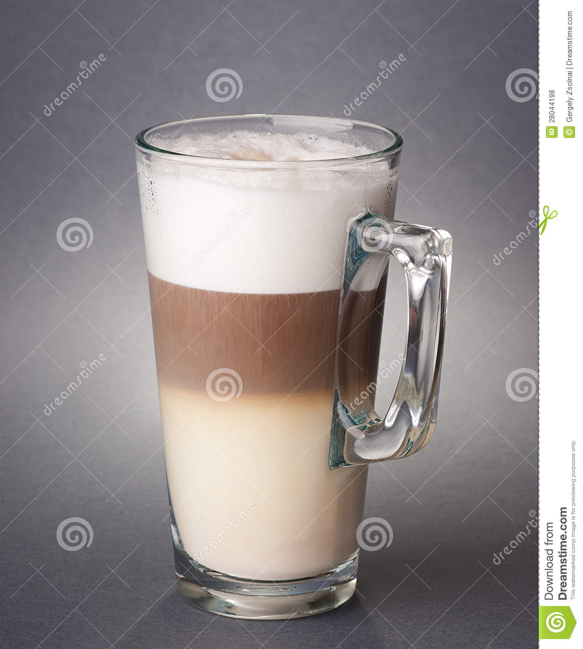 glass of latte macchiato on the gray background royalty free stock photos image 28044198. Black Bedroom Furniture Sets. Home Design Ideas
