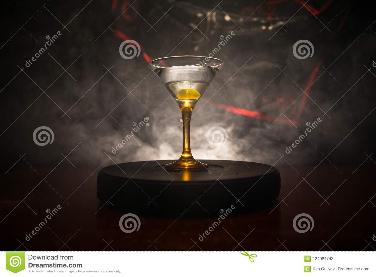97621fccdecb glass with martini with olive inside. Close up view of glass with club  drink on