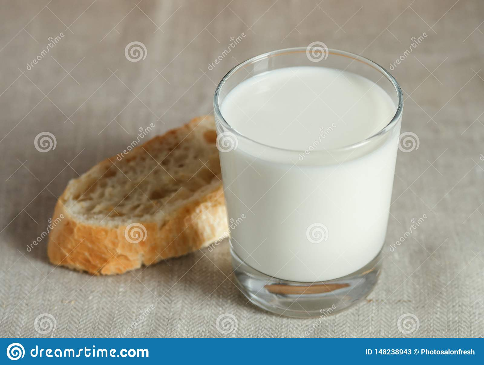 Glass of milk with fresh bread