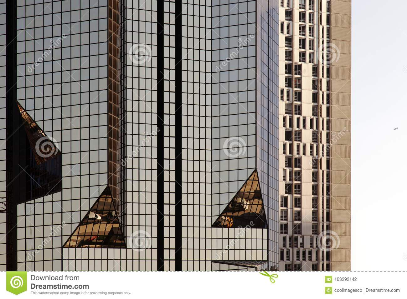 A glass modern building with geometric angles and reflection
