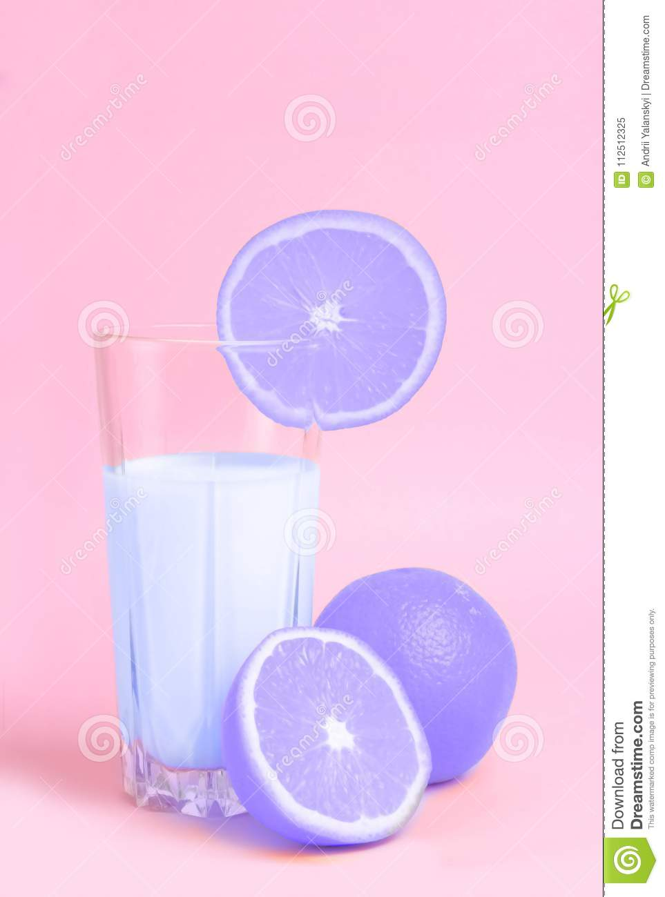 A glass with orange juice with the cut oranges on a pink background. Juicy color scale, pin up, pop up styles. Food for breakfast