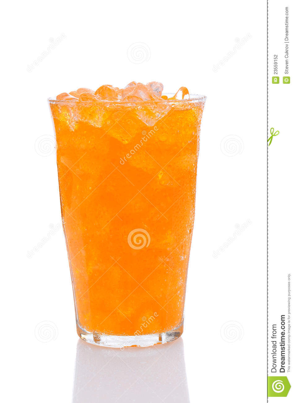 cold glass of orange soda filled with ice. Vertical format with a ...