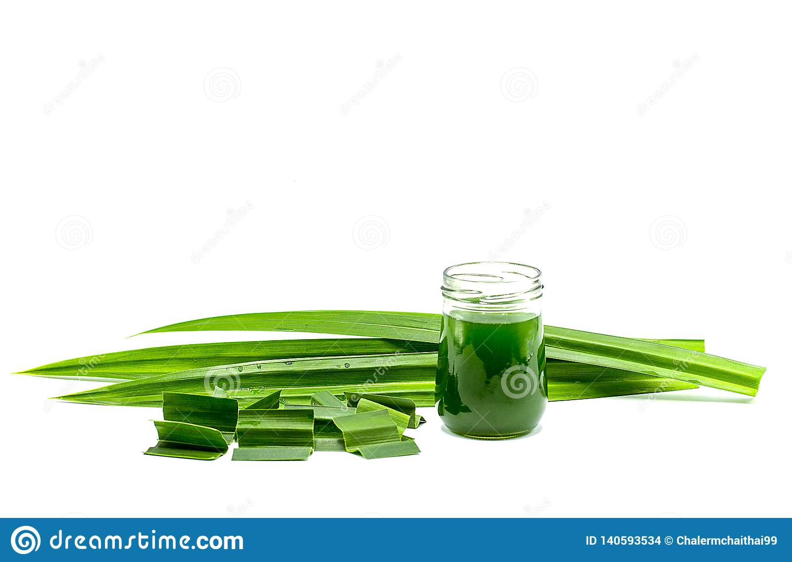 Glass of pandan juice and fresh Pandan leaves isolated on white background,copy space
