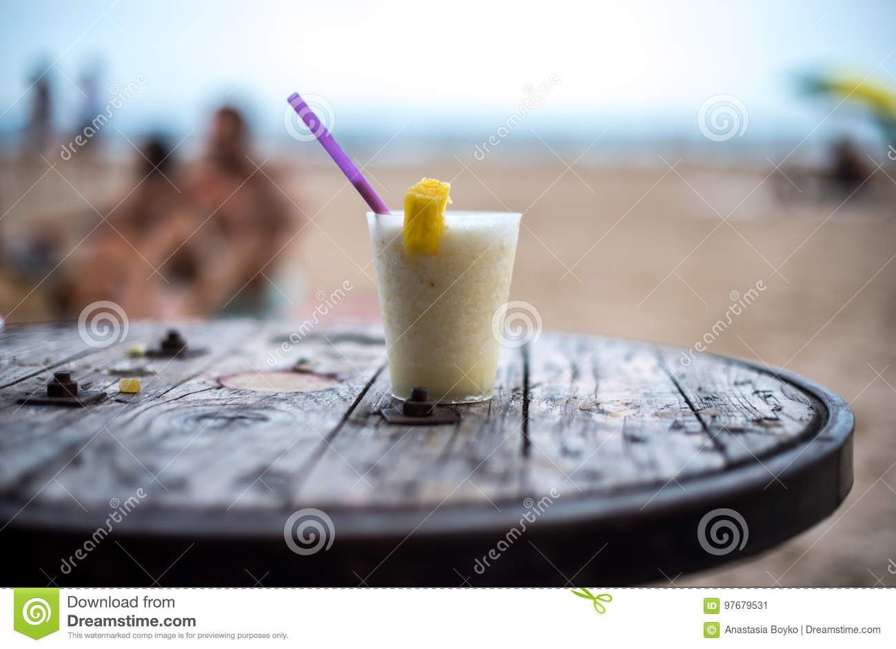Glass Of Pinacolada On The Table On The Beach Stock Image - Image of