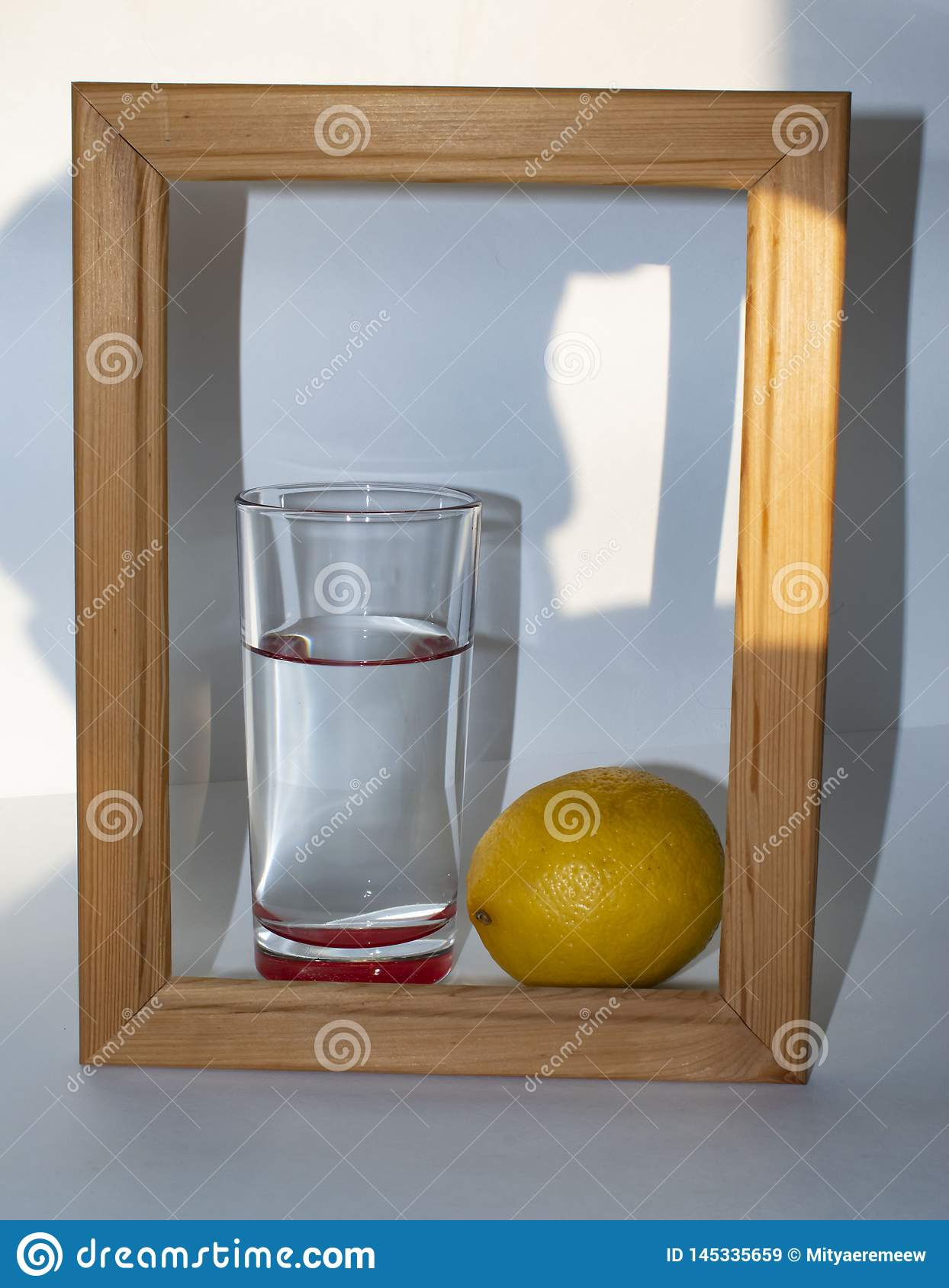 In a glass of pure clear water next to a lemon