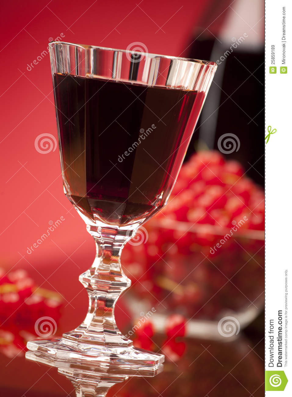 Glass of red fruit wine