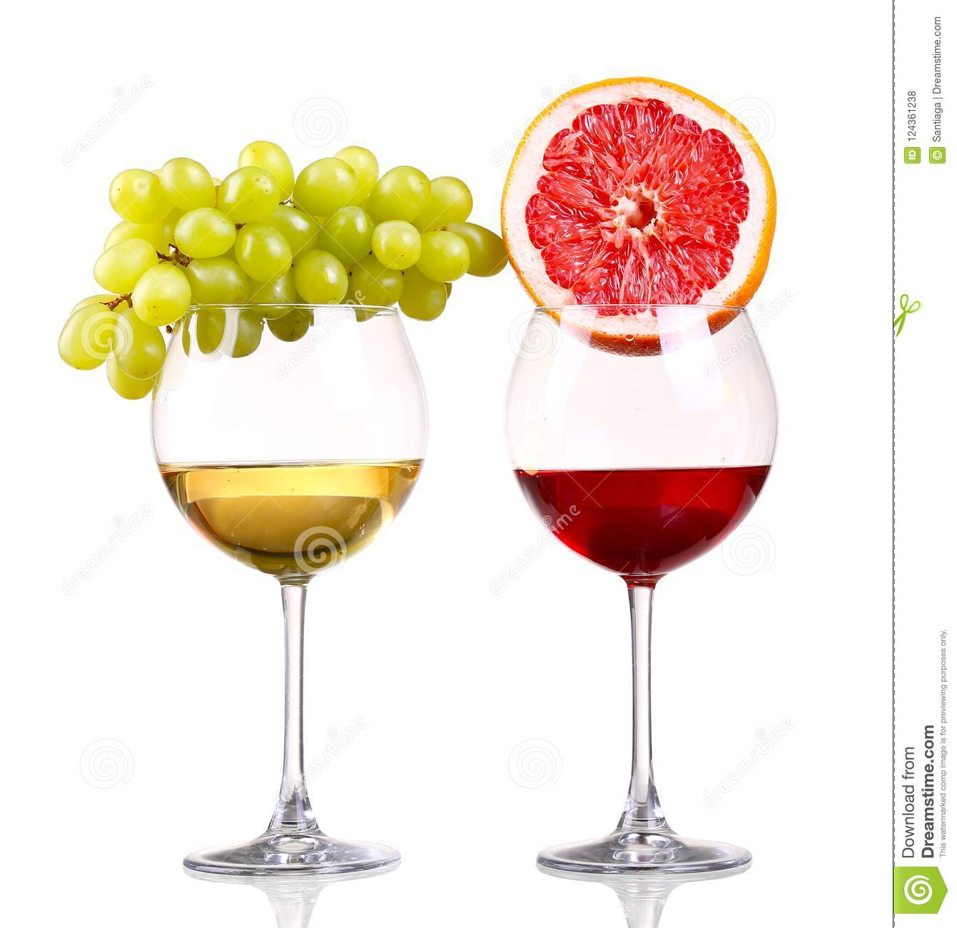 Glass of red and white wine, grape and grapefruit