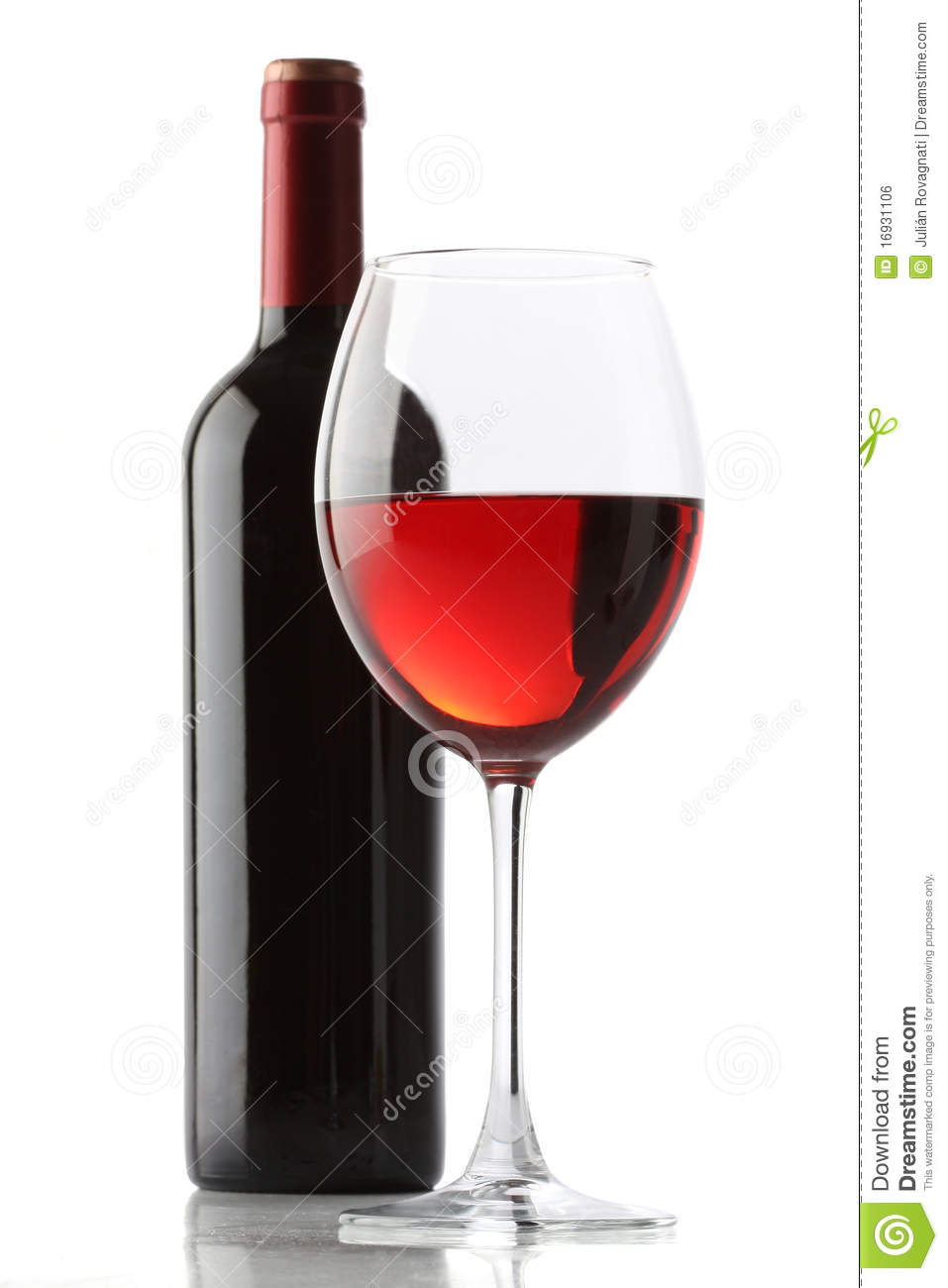 glass of red wine and a bottle bottle red wine