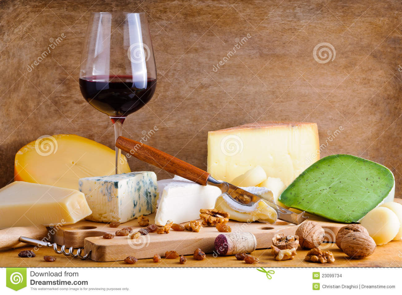 Glass of red wine and cheese plate