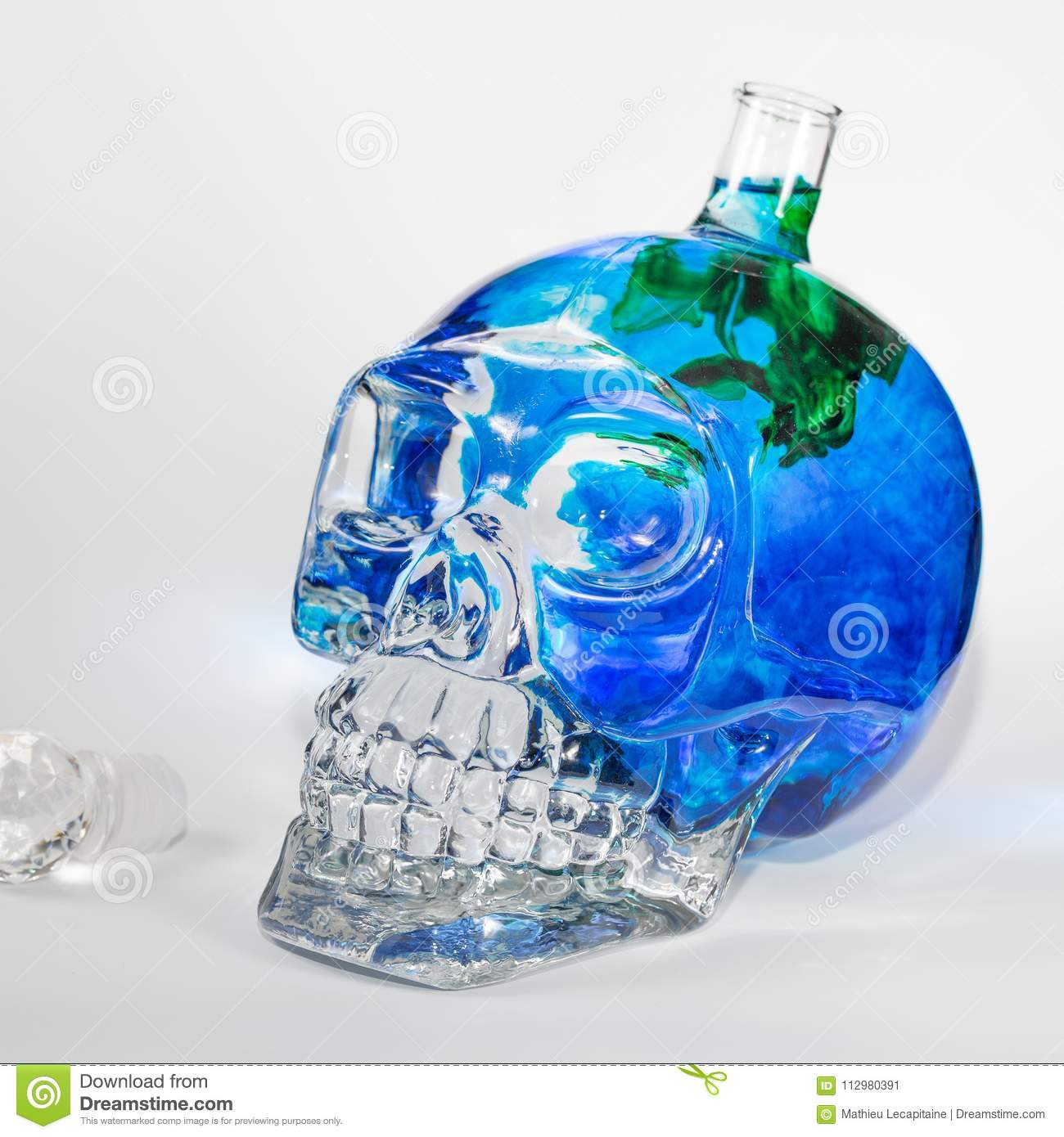 Glass skull with ink drops