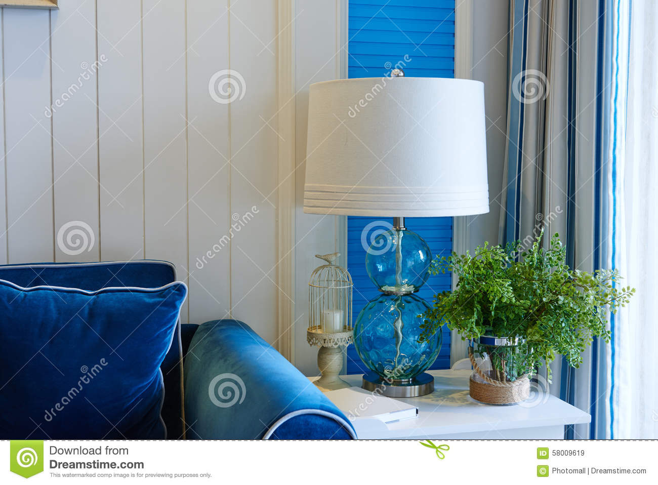 Brilliant Glass Table Lighting Beside Blue Sofa Stock Image Image Of Squirreltailoven Fun Painted Chair Ideas Images Squirreltailovenorg