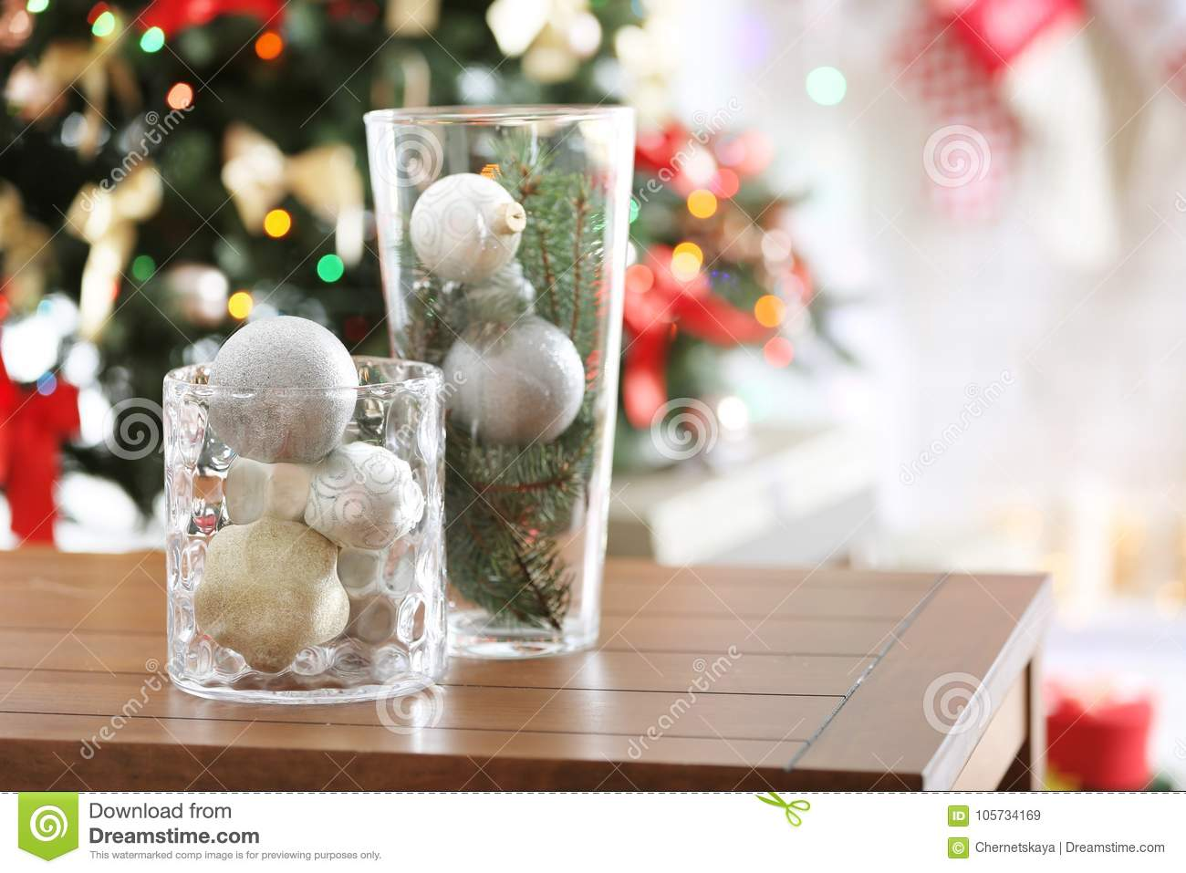 Glass vases with Christmas decoration on table