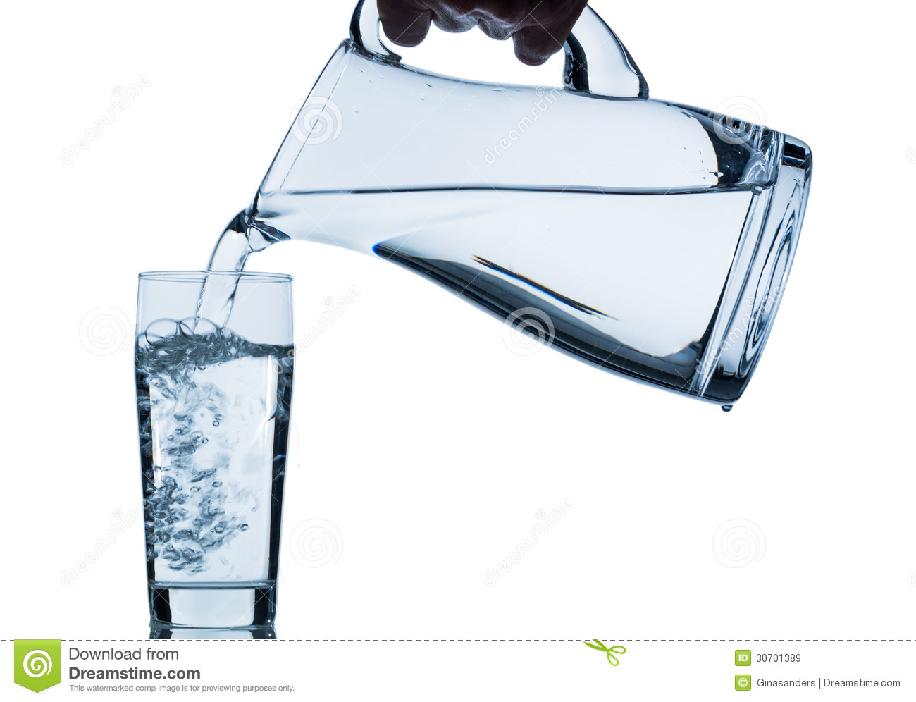 Pure water is emptied into a glass of water from a pitcher. fresh ...