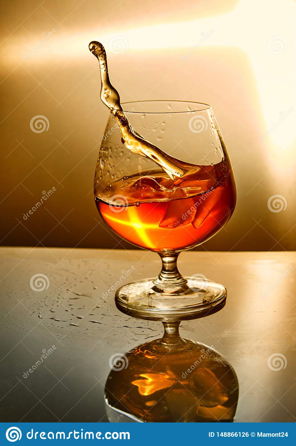 Glass of whiskey with a wave on an orange background