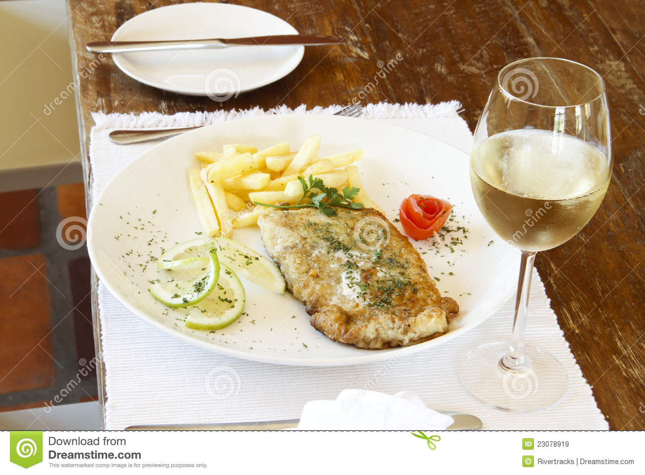 Glass of white wine with fish and chips royalty free stock for Wine with fish