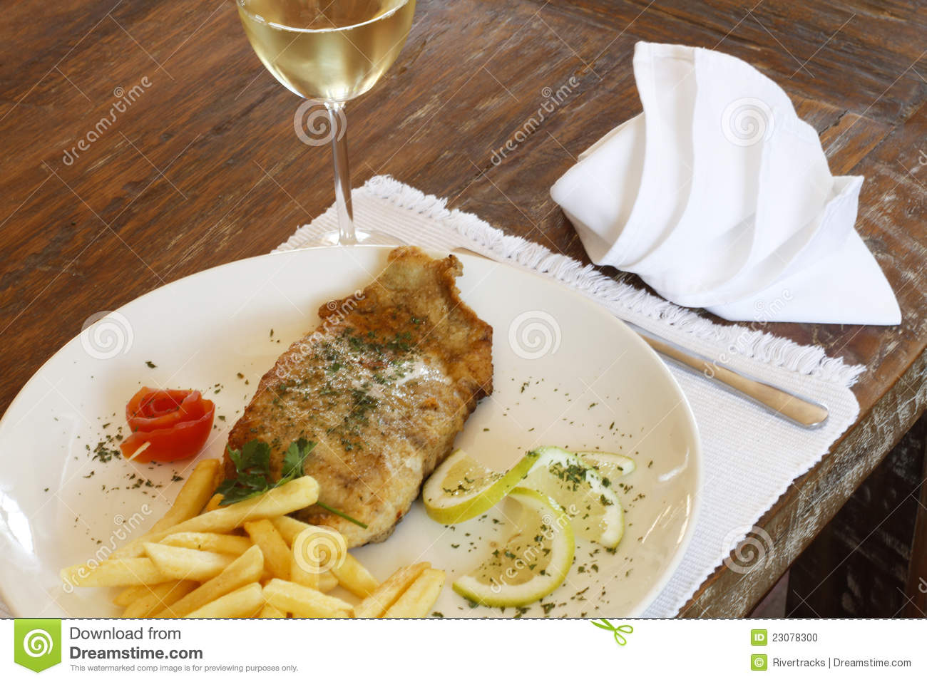 Glass of white wine with fried hake fish and chips stock for White wine with fish