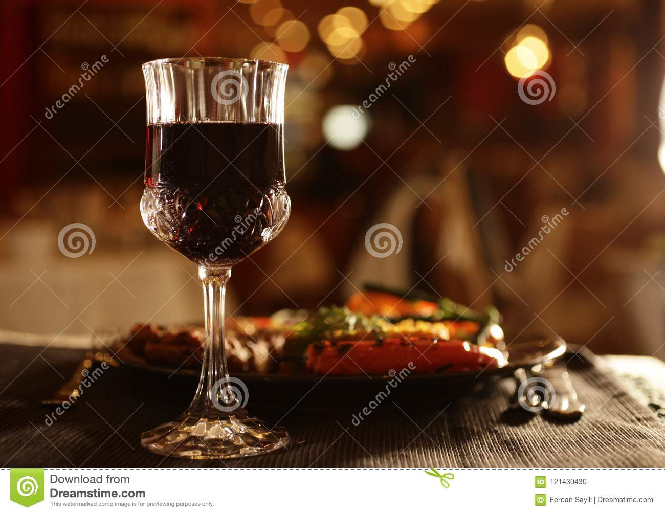 Glass of wine and dinner beside