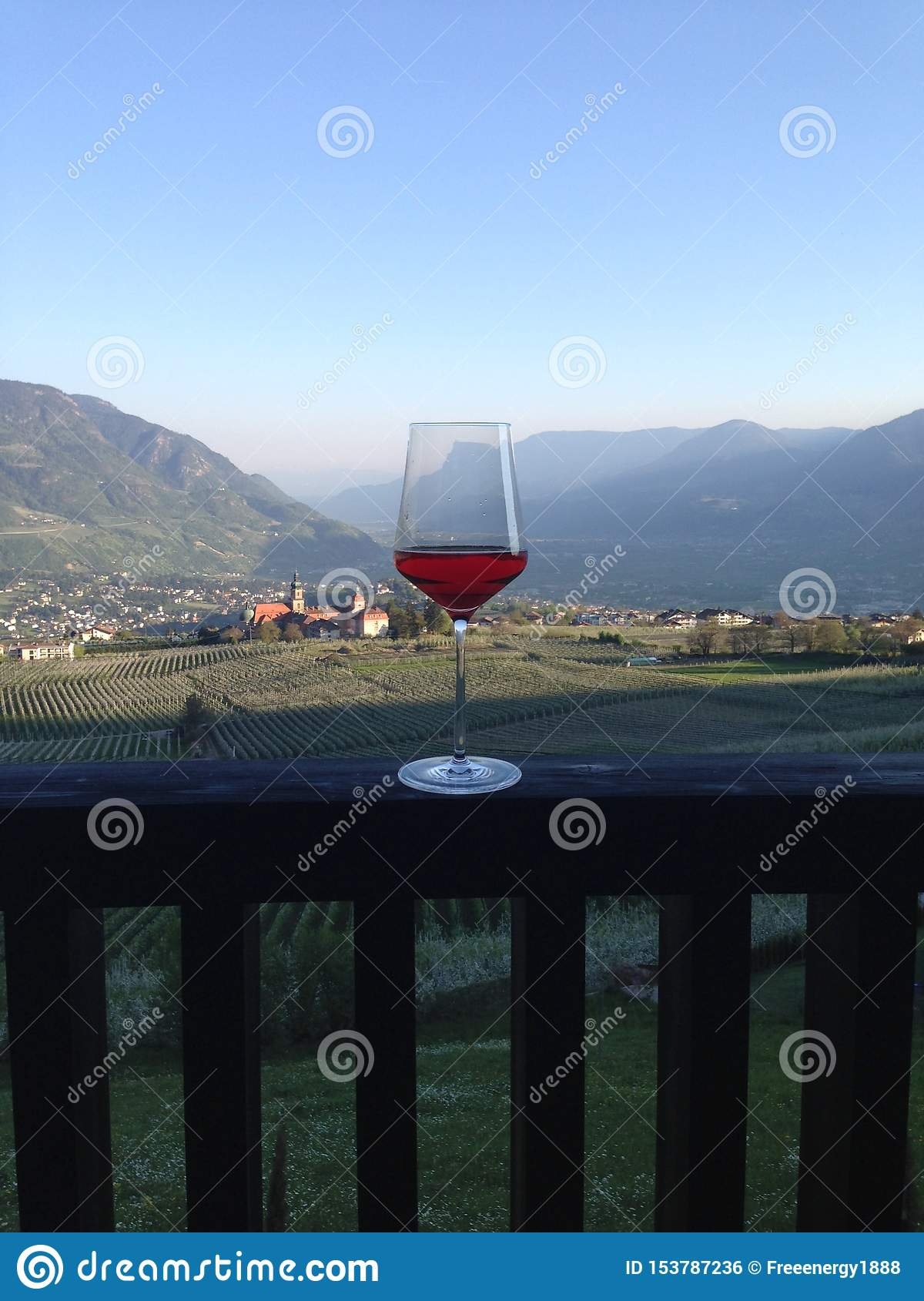 Glass of wine full of men`s passion and work