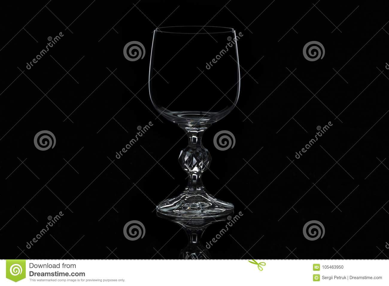 Glass wine glass isolated on a black background