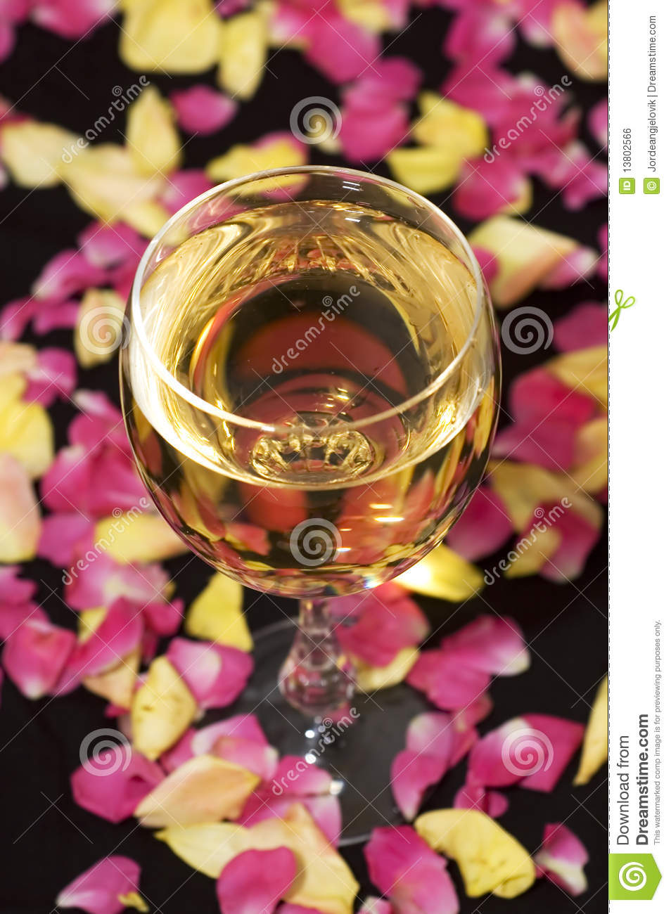 Glass of wine with leaves