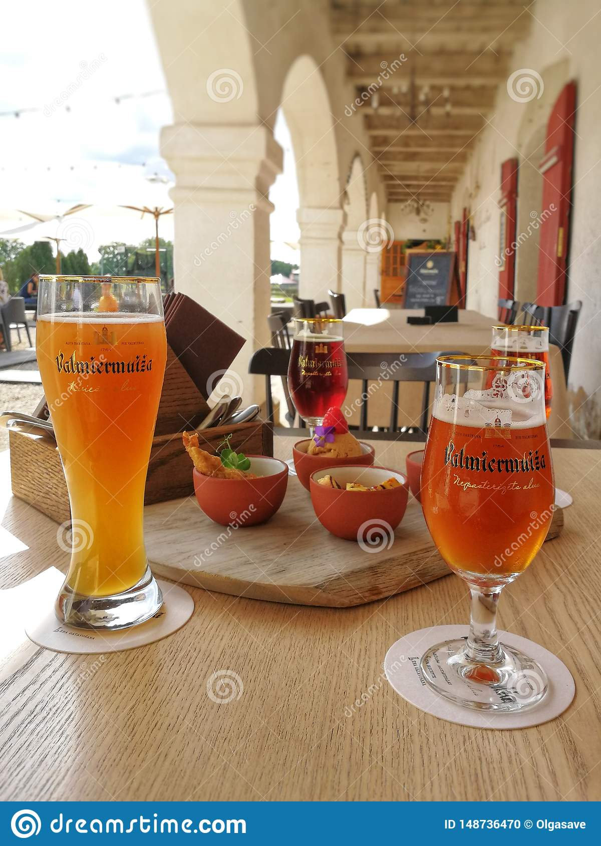 Glasses of beer and snacks on the table in the local restaurant near to the beer manufacture, Valmiera, Latvia