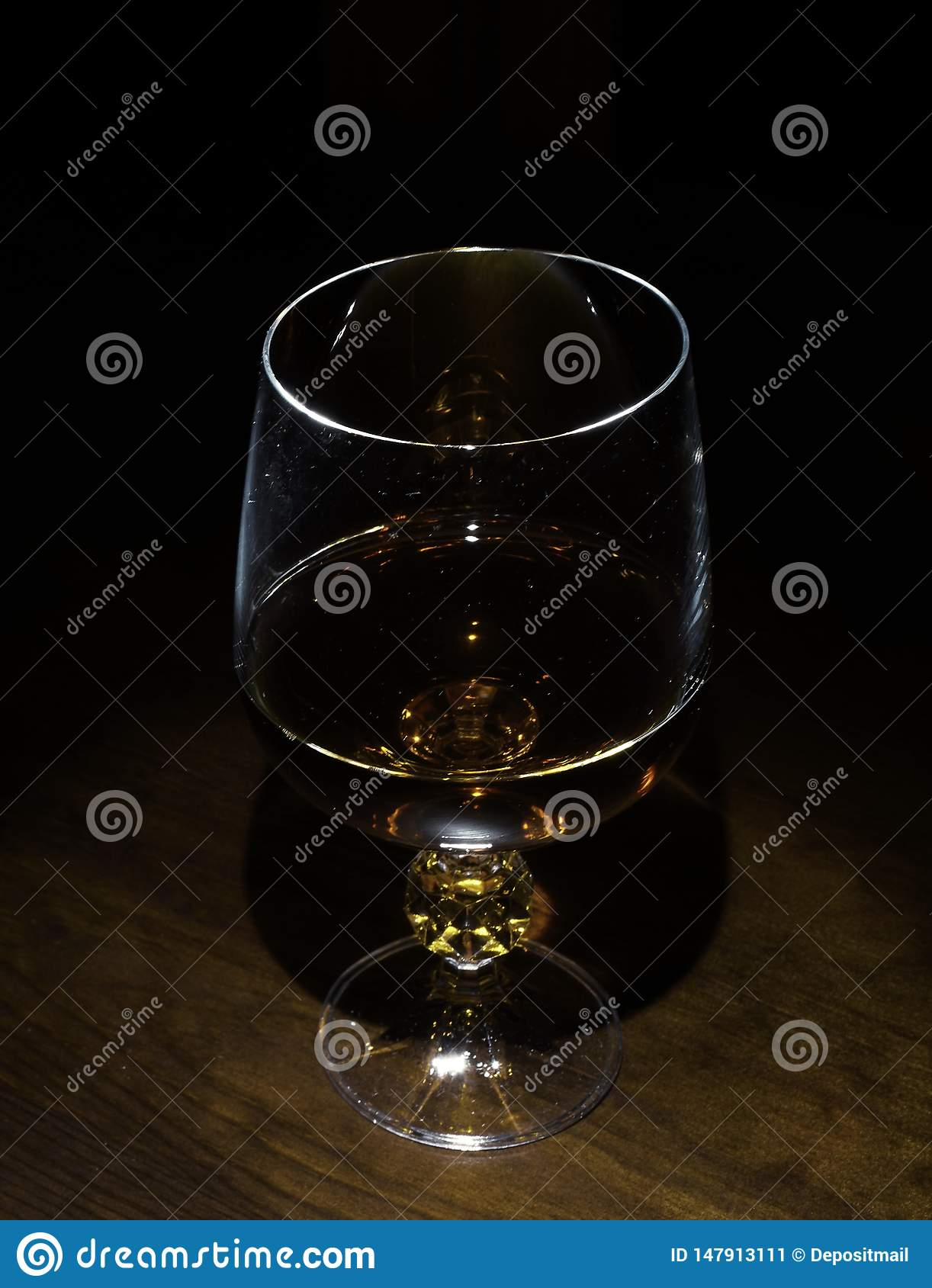 Glasses and candle on the table