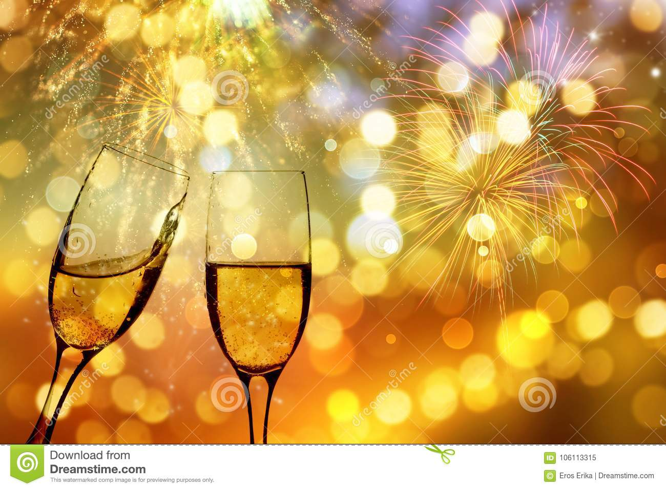 glasses with champagne against fireworks and holiday lights celebrating the new year