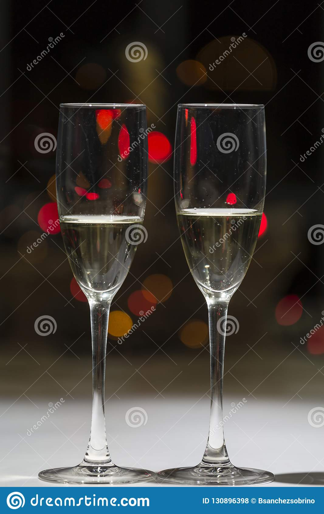 Glasses of champagne, in the background points of color