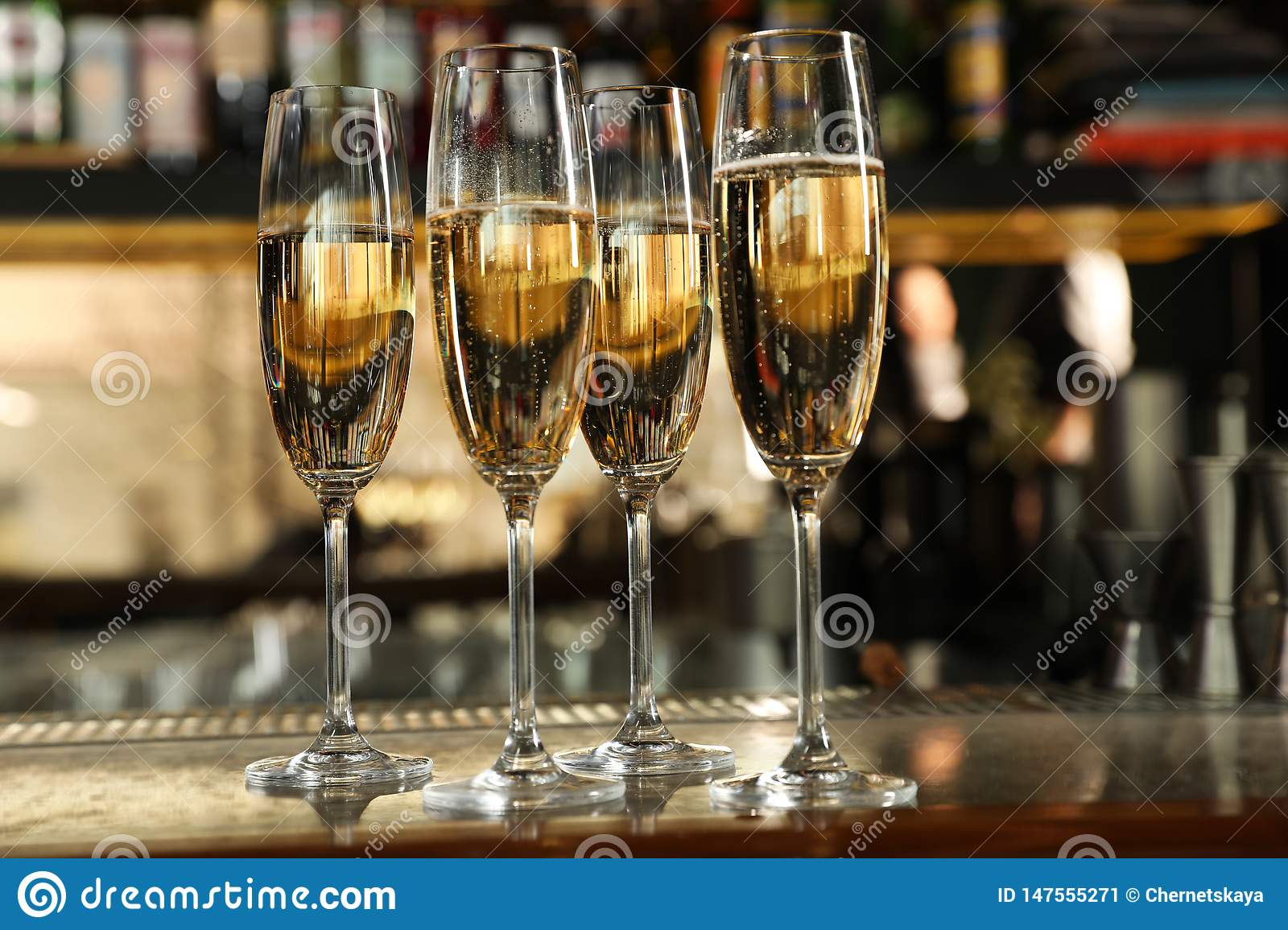 Glasses of champagne on counter