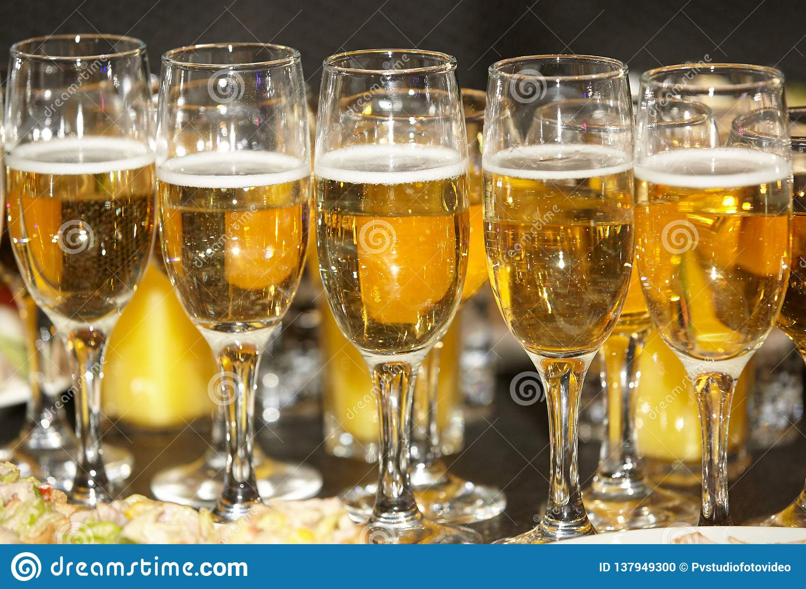 Glasses with champagne or wine of gold color