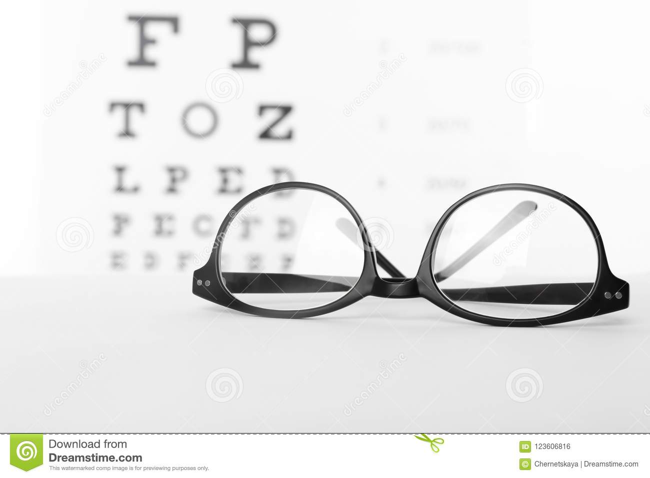 5024242130d6 Glasses With Corrective Lenses On Table Against Eye Stock Photo ...