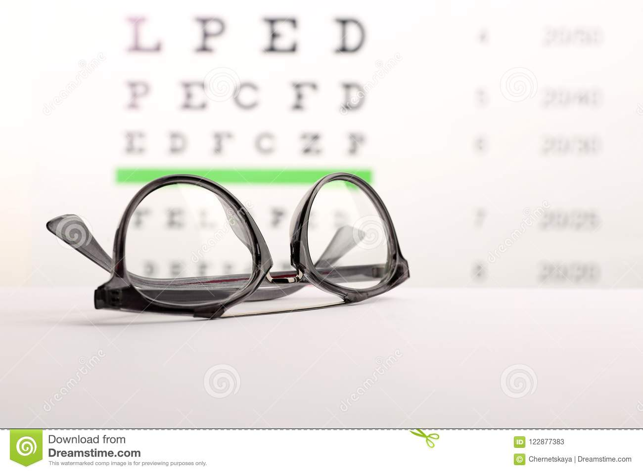 7c0f764a909a Glasses With Corrective Lenses On Table Stock Image - Image of chart ...