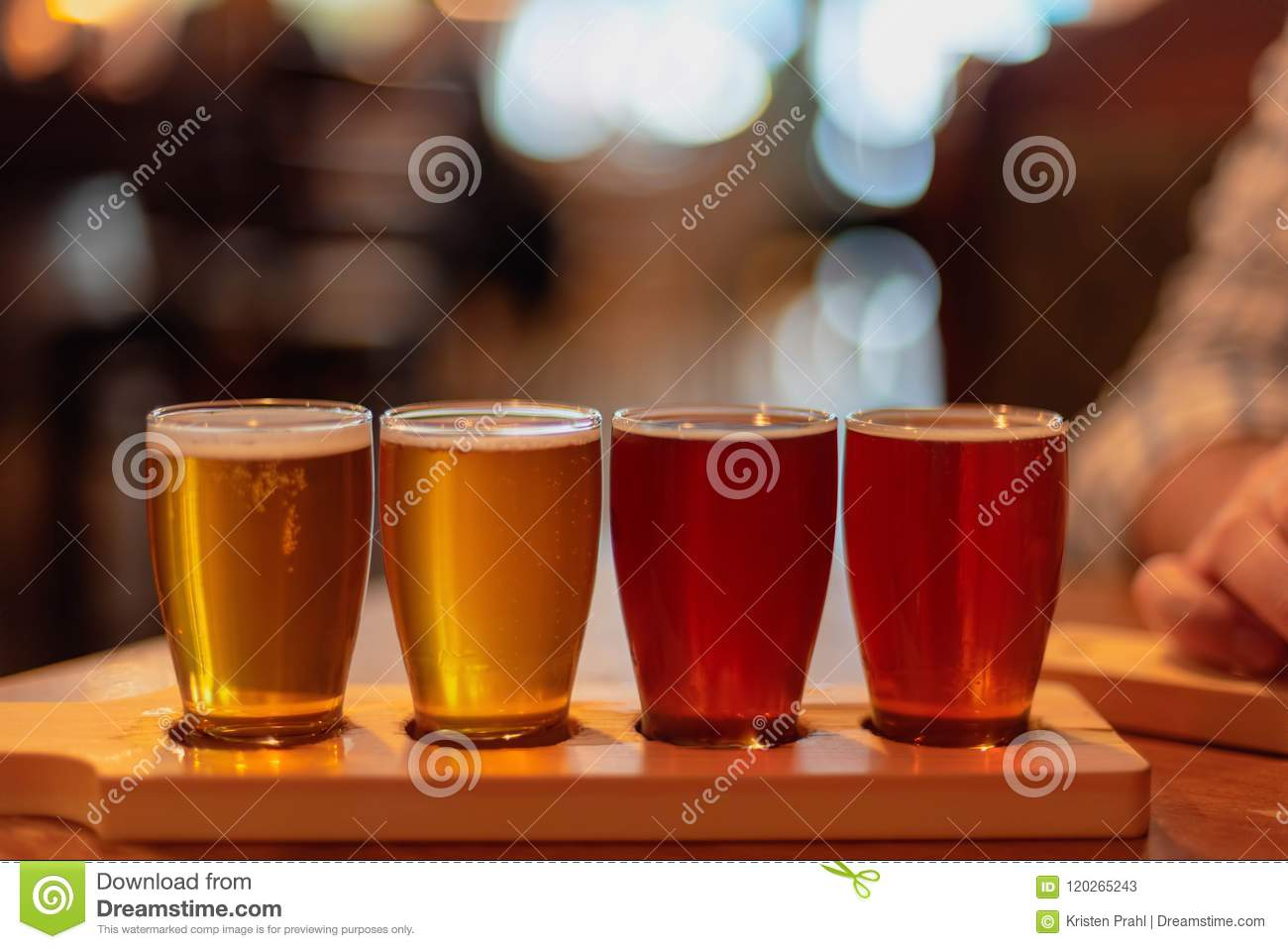 Glasses of craft beer lined up on the table